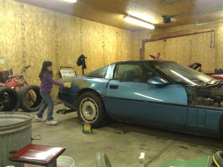 Johnna is washing a teal 1987 Corvette to find the pink one lurking underneath. She believed our joke for a full 5 seconds.