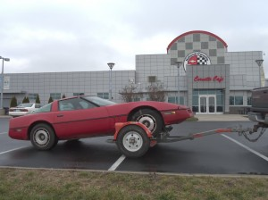 A 1984 Corvette on a tow dolly outside the National Corvette Museum