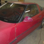 A red 1984 C4 Corvette before being restored. At this point, all I've done is wash the car.